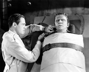 Patric Knowles as the scientist attempting to revive Frankenstein's monster (Bela Lugosi) in Frankenstein Meets the Wolf Man