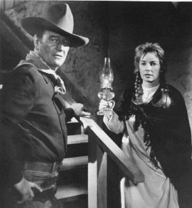"""John Wayne, competing with Jimmy Stewart for the love of Vera Miles in """"The Man Who Shot Liberty Valance"""""""