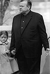 Orson Welles holding young girl's hand