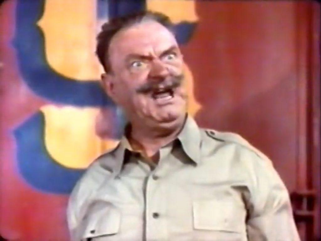 Sig Ruman as Colonel Fritz Schlitz, lion tamer