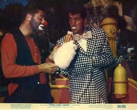 Jericho (Jerry Lewis) offering cotton candy to Dean Martin in 3 Ring Circus
