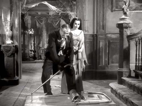 Come Back, Little Googie - Grandpa (Al Lewis) and Lily (Yvonne De Carlo) setting out a mousetrap.  A BIG mousetrap