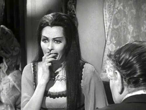 Lily Munster looking worried