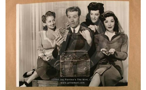 """Publicity photo of Red Skelton, Ann Rutherford, and the other lovely ladies (and the treasure) in """"Whistling in Dixie"""""""