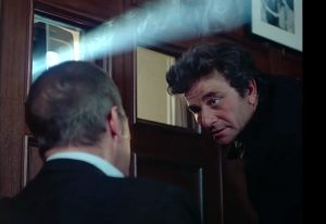 Columbo (Peter Falk) and Ned Diamond (John Payne) in the projection room