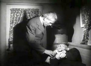 Dr. Niemann (Boris Karloff) threatening in House of Frankenstein